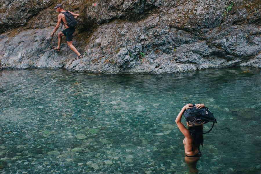 People bathing at a natural waterfall spring shot at Samothraki on August of 2016, image by Ilias Antoniou.