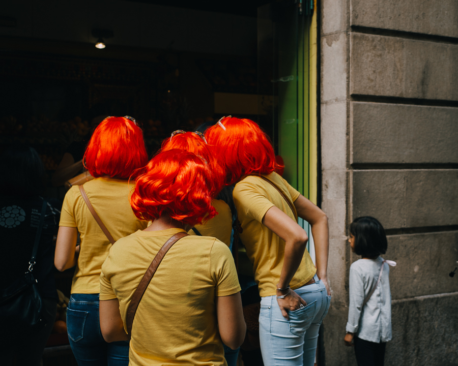 Group of red wigged girls vs dark haired girl, photography by Ilias Antoniou