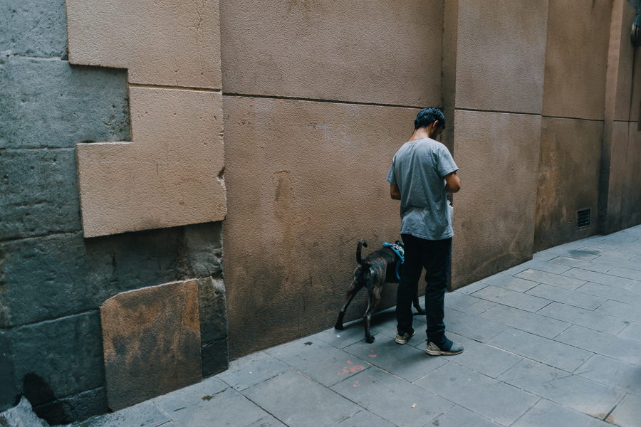 Man with dog in alley, photography by Ilias Antoniou