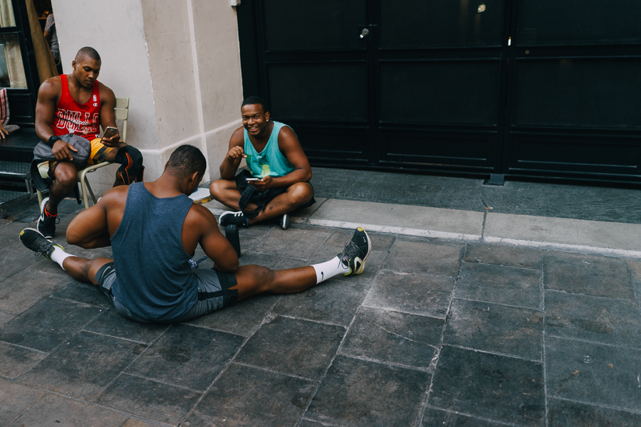 Group of basketball players sitting at the streets of Barcelona, Spain, photography by Ilias Antoniou